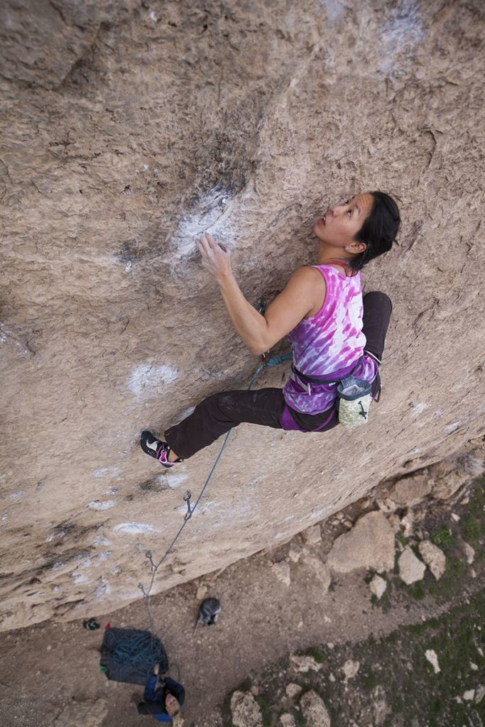 Woman rock climbing in Lander, Wyoming