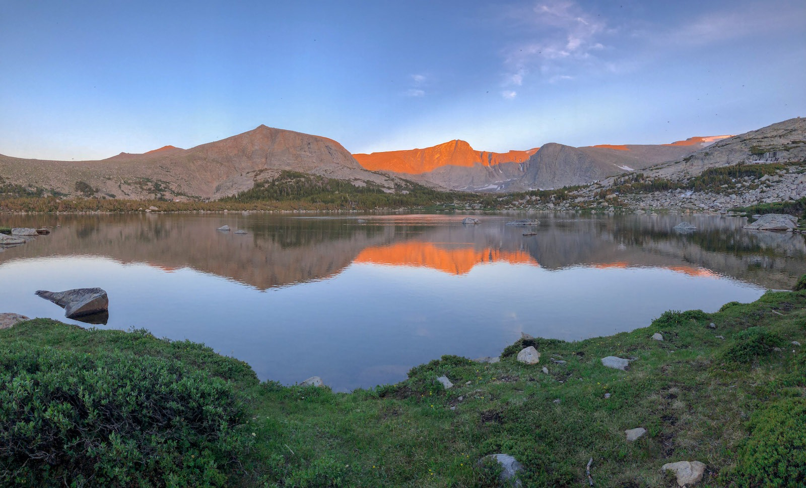 Sunset over an alpine lake in Wyoming in the Wind River Mountains