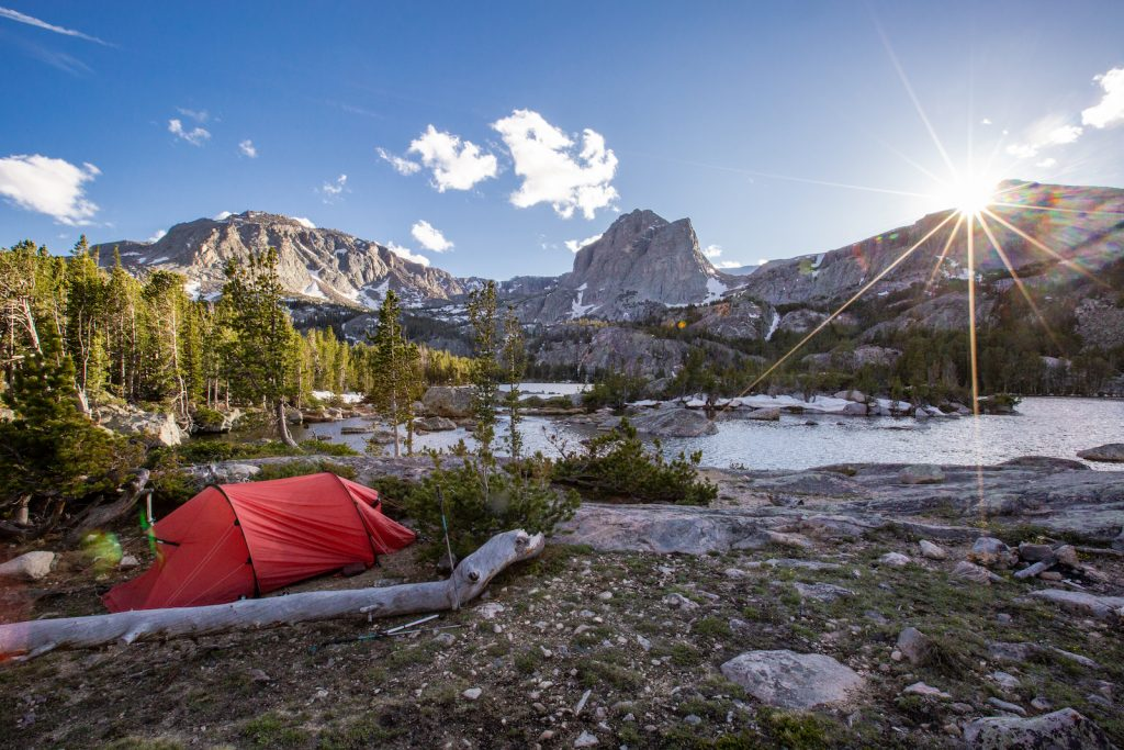 Backpacking near Lander: Tent near lake at sunrise