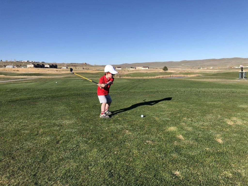 Kid golfing in Lander, Wyoming